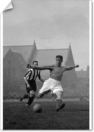 Bill 'Dixie' Dean of Everton shoots for goal at Goodison Park