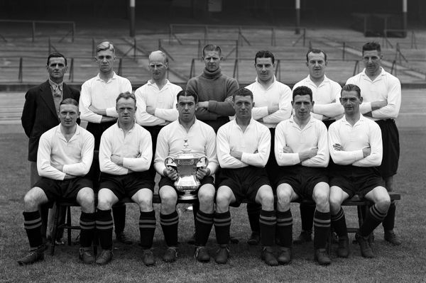 FA Cup winners Everton Back row (left-right): Harry Cook (trainer), Cliff Britton, Warney Cresswell, Ted Sagar, Billy Cook, Tom White, Jock Thomson Front row (left-right): Albert Geldard, Jimmy Dunn, Bill 'Dixie' Dean, Tom Johnson, Jimmy Stein