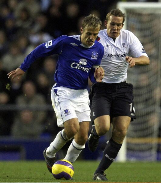 Everton v Bolton - Everton's Phil Neville and Bolton's Kevin Davies