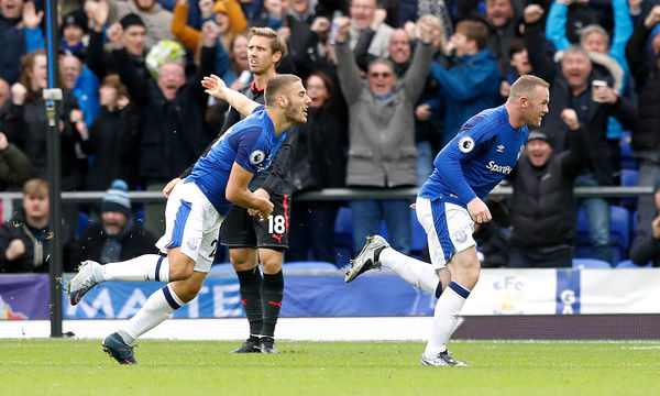 Everton's Wayne Rooney (right) celebrates scoring his side's first goal of the game