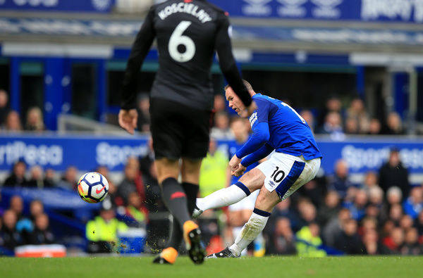 Everton's Wayne Rooney scores his side's first goal of the game during the Premier League match at the Goodison Park, Liverpool