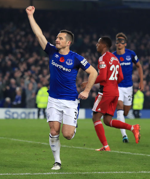 Everton's Leighton Baines celebrates scoring his side's third goal of the game from the penalty spot during the Premier League match at Goodison Park, Liverpool