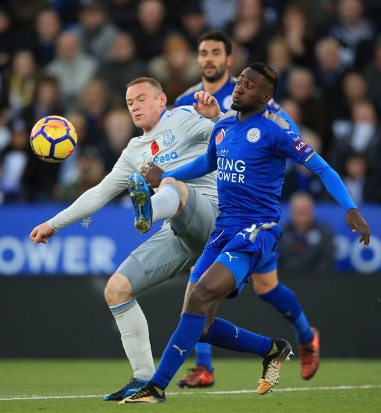 Leicester City's Wilfred Ndidi and Everton's Wayne Rooney battle for the ball during the Premier League match at the King Power Stadium, Leicester
