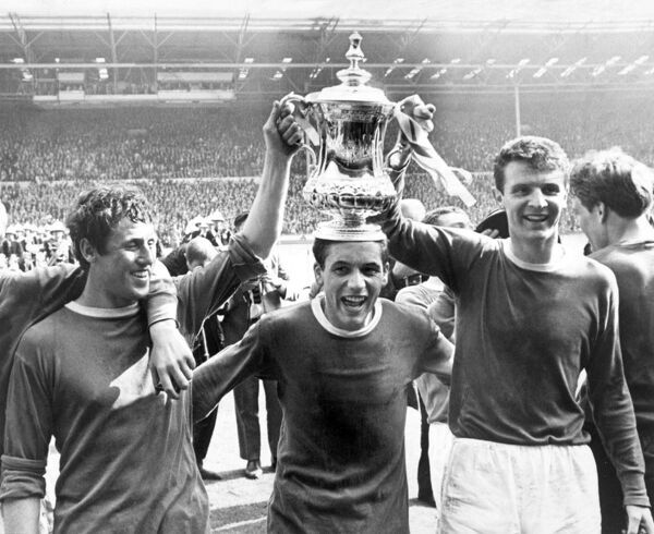 Everton's two-goal hero Mike Trebilcock (c) is crowned with the FA Cup by teammates Brian Harris (l) and Brian Labone (r) after their 3-2 victory