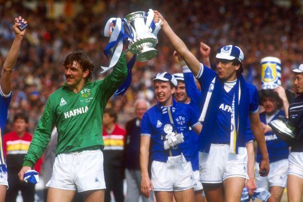 Everton goalkeeper Neville Southall (l) holds up the FA cup with teammate Graeme Sharp (r) after Everton ran out 2-0 winners over Watford