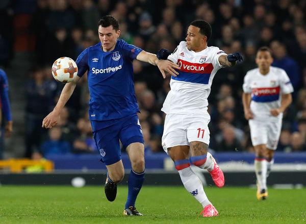 Everton's Michael Keane (left) and Olympique Lyonnais' Memphis Depay battle for the ball