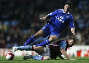 Aston Villa's Bardsley challenges Everton's Arteta for the ball during their