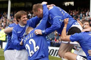 Duncan Ferguson is mobbed after his goal.