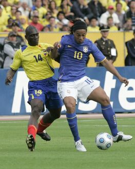 Ecuador's Castillo fights for the ball Brazil's Ronaldinho during their World