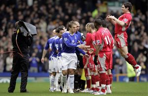 Everton v Blackburn Rovers Phil Neville leads his team as they shake hands with the