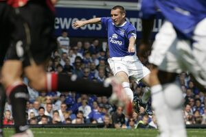 Everton's Stubbs shoots to score during their English Premier League soccer match