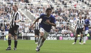 Everton's Tim Cahill celebrates scoring the first goal for his side