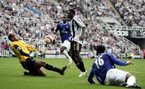 Everton's Tim Howard saves from Newcastle's Obafemi Martins