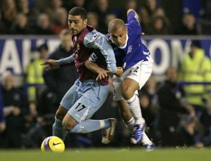 Everton's Vaughan challenges West Ham United's Mullins for the ball during
