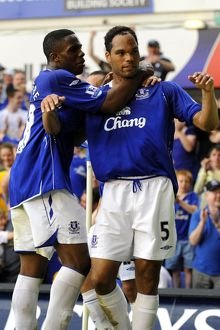 Football - Everton v Newcastle United Barclays Premier League - Goodison Park - 11/5/08 Everton's Joleon Lescott (R) celebrates scoring his sides second goal with team mate Victor Anichebe Mandatory Credit: Action Images / Keith Williams Livepic