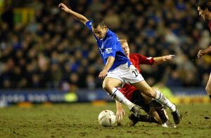 Leon Osman is fouled by Paul Scholes.