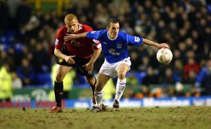 Leon Osman gets the better of Wes Brown.