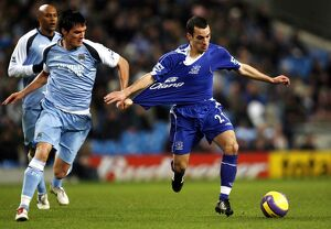 Manchester City v Everton Everton's Leon Osman and Manchester City's Stephen