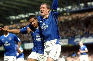 Tim Cahill congratulates David Weir on his opening goal.