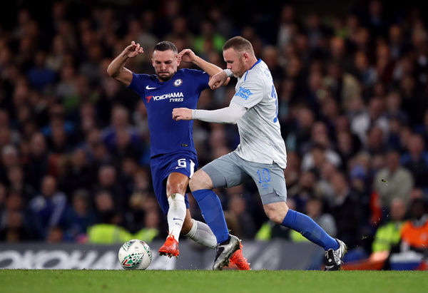 Chelsea's Danny Drinkwater (left) and Everton's Wayne Rooney battle for the ball