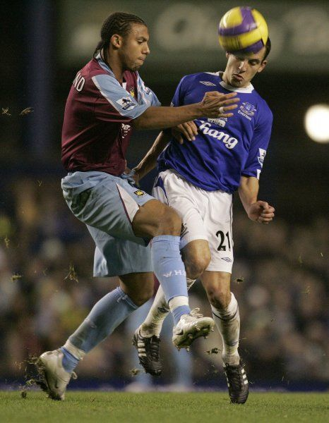 Everton's Leon Osman (R) challenges West Ham United's Anton Ferdinand for the ball