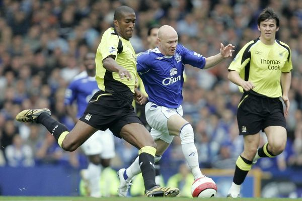 Manchester City's Sylvain Distin battles with Everton's Andrew Johnson