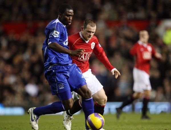 Manchester United v Everton Joseph Yobo Everton in action against Wayne Rooney