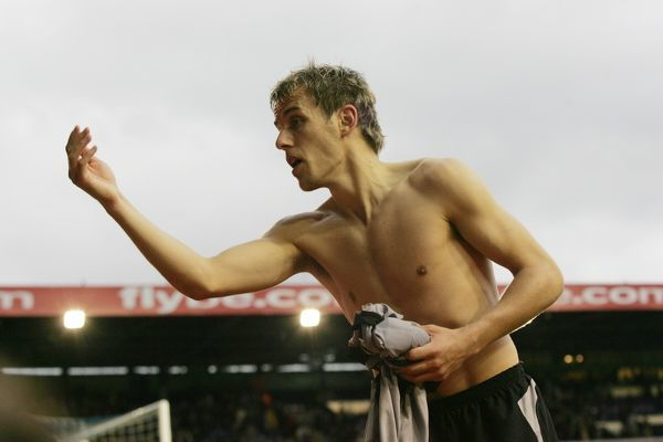 Phil Neville prepares to throw his shirt to fans