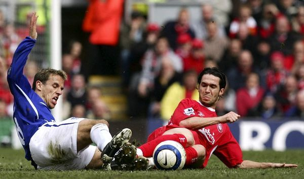 Philip Neville gets a strong tackle in on Luis Garcia Mandatory Credit: Action Images / Michael Regan Livepic