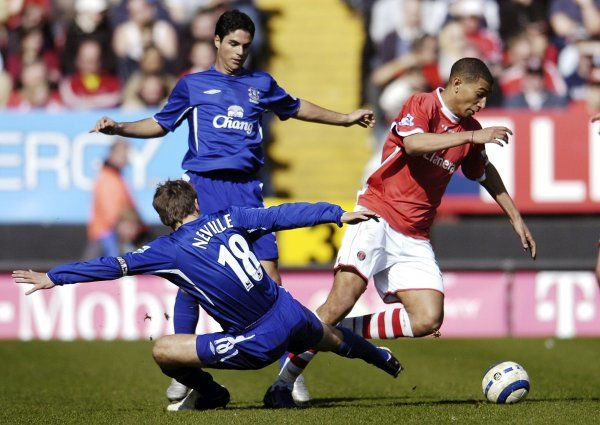 Neville and Arteta try to dispossess Jay Bothroyd Mandatory Credit: Action Images / Tony O'Brien Livepic