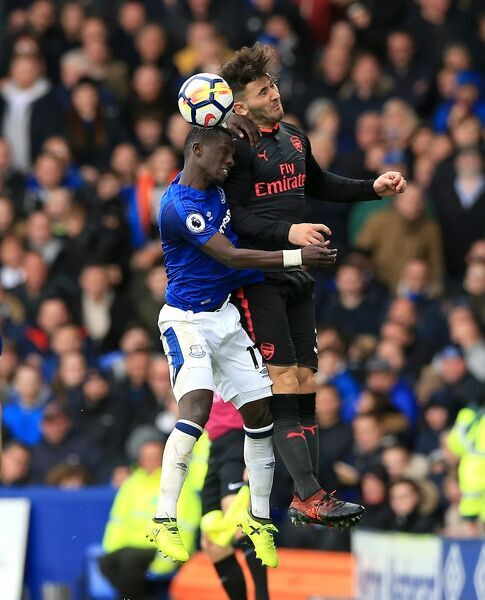 Everton's Idrissa Gueye (left) and Arsenal's Sead Kolasinac (right) battle for the ball in the air during the Premier League match at the Goodison Park, Liverpool