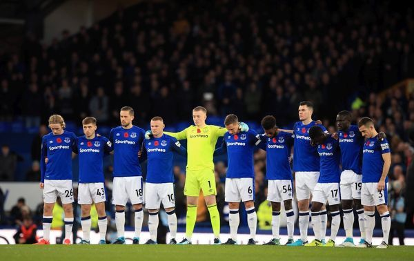 Everton players observe a minutes silence for Armistice Day before the Premier League match at Goodison Park, Liverpool