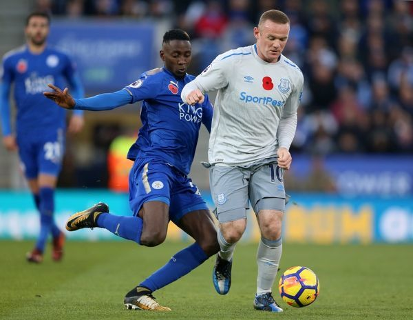 Leicester City's Wilfred Ndidi (left) and Everton's Wayne Rooney battle for the ball