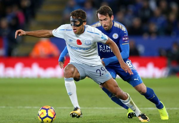 Everton's Dominic Calvert-Lewin (left) and Leicester City's Christian Fuchs battle for the ball