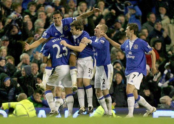 Everton's Tim Cahill (left) celebrates with his team mates after scoring their second goal