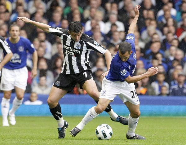 Newcastle United's Joey Barton (left) and Everton's Leon Osman (right)