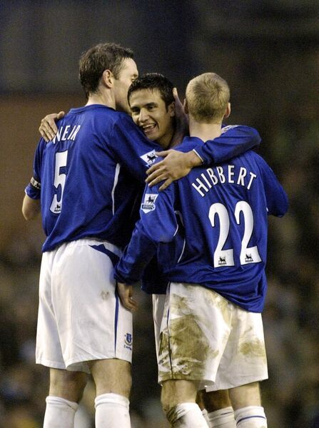 David Weir celebrates at the end with Tony Hibbert and Tim Cahill Mandatory Credit: Action Images / Paul Currie Livepic