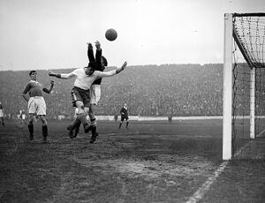 'Dixie' Dean Everton in action with Millington, the Chelsea goalkeeper, at