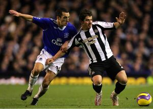 Everton v Newcastle United Leon Osman and Newcastle's Emre in action