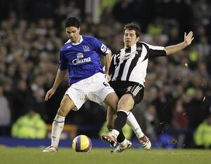 Everton v Newcastle United - Mikel Arteta and Emre in action