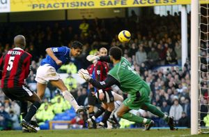 Tim Cahill heads home
